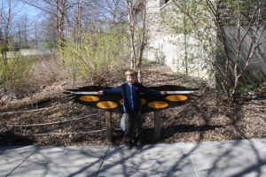 Ethan measuring his wingspan.