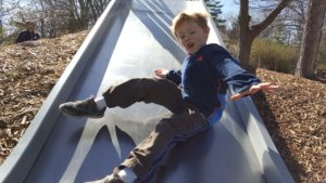 Ethan showed off his tricks on the slide.