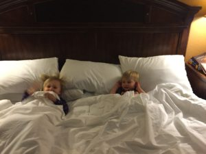 Every day Emma & Tyler would snuggle in Grandma and Grandpa's bed.