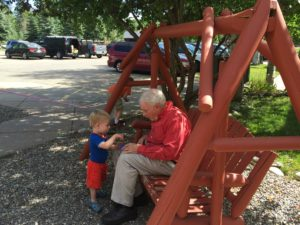 Quality time with Grandpa on the porch swing.