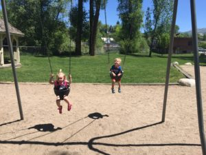 Emma and Tyler could swing all day long.